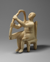 Seated harp player
