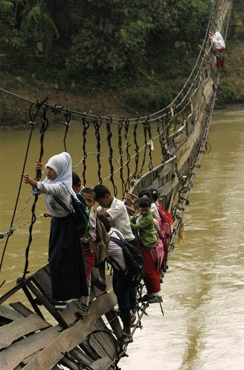 Children crossing bridge Indonesia